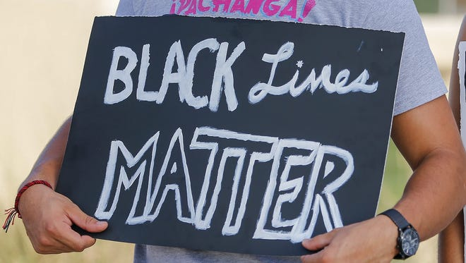 A Black Lives Matter protester demonstrates in Dallas.