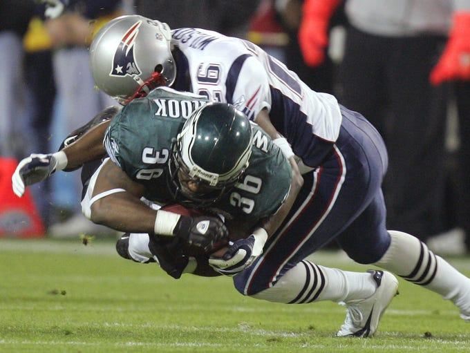 New England Patriots' Eugene WIlson (26) tackles Philadelphia