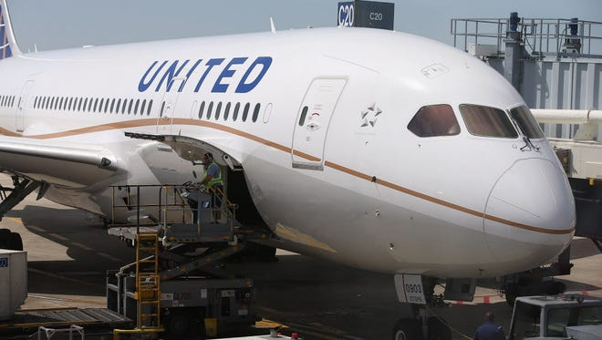 A United Airlines Boeing 787 Dreamliner prepares for a flight at O'Hare International Airport after it arrived from Houston on May 20, 2013.