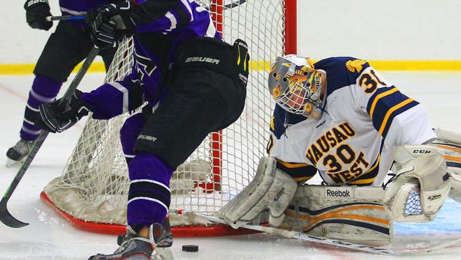 Wausau West goalie Jacob Warnke eyes the puck during the Warriors win over Mosinee in a Marathon Cup semifinal game Thursday.