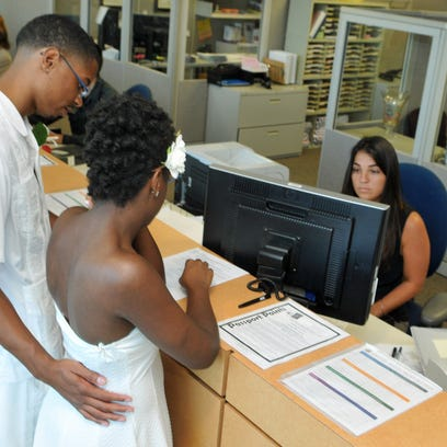 Chris and Nesha Jex, of Cocoa, get their marriage license