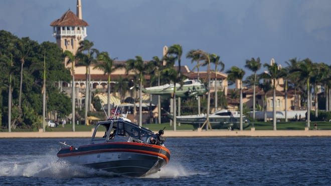 """The U.S. Coast Guard patrols the water as the Marine One helicopters land at Mar-a-Lago to pick up President Trump in Palm Beach on Jan. 3, 2020. The president was headed to the kickoff meeting of """"Evangelicals for Trump"""" at the King Jesus International Ministry, a mega-church in Miami."""