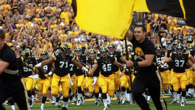 The Iowa Hawkeyes run onto the field prior to their game against Northern Iowa at Kinnick Stadium on Aug. 30.