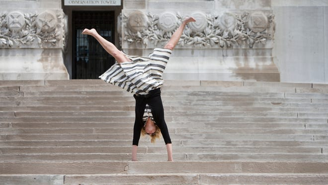 Amanda Kingsbury does a cartwheel on the stairs of the Soldiers and Sailors Monument Tuesday, June 17, 2014.