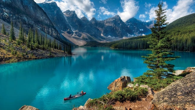 Guests at Moraine Lake Lodge in Alberta, Canada, can take a canoe out on the emerald-colored water of Moraine Lake.