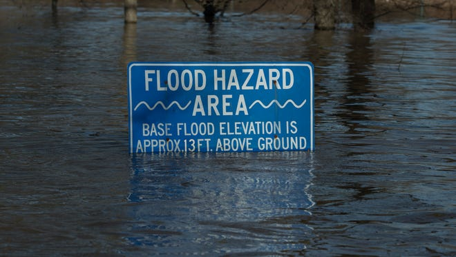 A flood hazard sign along River Road in Louisville, Kentucky after weekend flooding led to the highest point for the Ohio River's waters Monday. Feb. 26, 2018