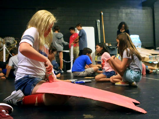 Kendall Zenthoeser works on painting a piece of her prop during the Harbor Playhouse Summer Camp on Wednesday, July 19, 2017, in Corpus Christi.