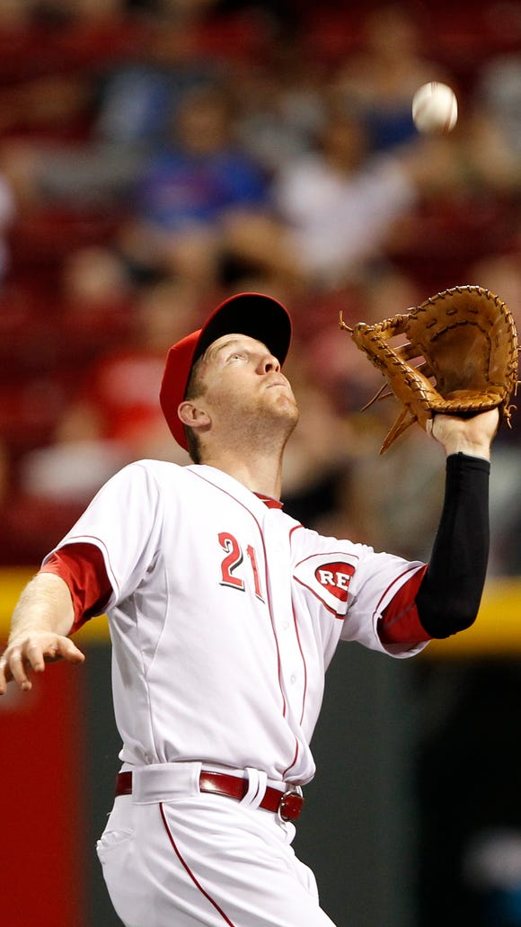 Cincinnati Reds third baseman Todd Frazier (21) makes a play during the third inning against the Chicago Cubs at Great American Ball Park.