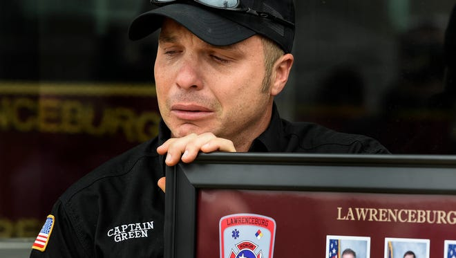 Capt. Brian Green cries as Fire Chief Jay Moore addresses the media about the loss of fire fighter Jason Dickey at the Lawrenceburg Fire Department Station 1 in Lawrenceburg, Tenn., Tuesday, Feb. 13, 2018.