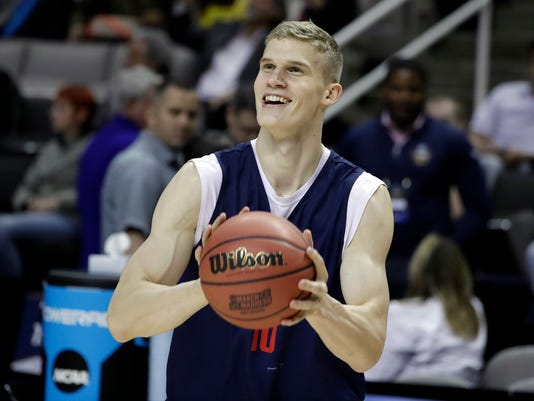 FILE - In this March 22, 2017, file photo, Arizona forward Lauri Markkanen smiles during practice in San Jose, Calif. Markkanen is a likely lottery pick in Thursday's NBA draft after one season at Arizona. (AP Photo/Marcio Jose Sanchez, File)