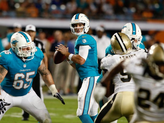 Aug 29, 2013; Miami Gardens, FL, USA; Miami Dolphins quarterback Pat Devlin (7) drops back to pass against the New Orleans Saints in the second quarter at Sun Life Stadium. Mandatory Credit: Robert Mayer-USA TODAY Sports