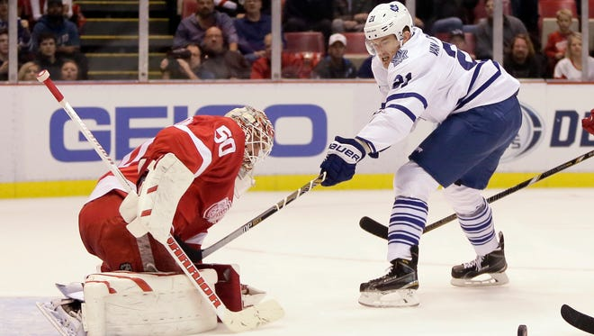 Toronto Maple Leafs' James van Riemsdyk has his shot deflected by Detroit Red Wings goalie Jonas Gustavsson (50), of Sweden, during the first period of an NHL hockey games Saturday, Oct. 18, 2014, in Detroit.