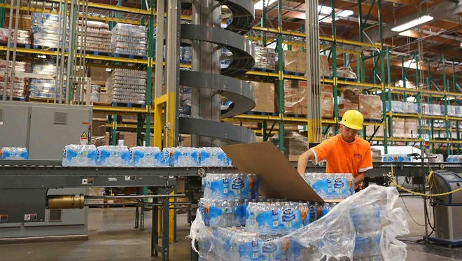 A worker packages bottled water at a Nestle bottling plant in Ontario, Calif. The company bottles both spring water and purified water at the plant.