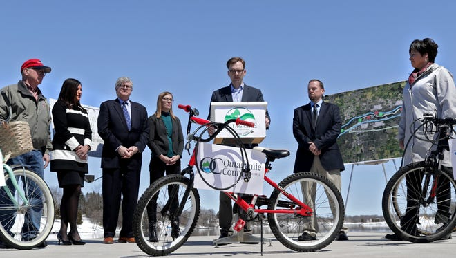 Fox Cities leaders gather Thursday at Sunset Park in Kimberly to announce a plan to build a trail joining five communities in the Fox Cities. The proposed Loop the Locks trail is expected to cost about $6 million.