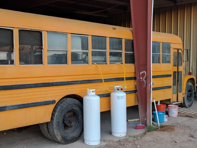 A school bus where farm workers were housed at G Farms