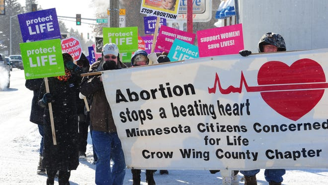 Marchers with the Crow Wing Chapter of Minnesota Citizens Concerned For Life brave freezing temperatures in Brainerd, Minn., Jan. 22 on the anniversary of the 1973 Supreme Court decision that declared a constitutional right to abortion.