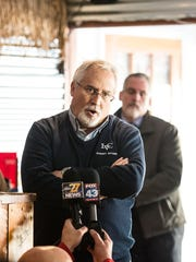 Greg Krikorian, vice president of student affairs and dean of students at Lebanon Valley College, addresses Nikki Meyer, owner of Just Wing It in Annville, and Christopher Behney, founder of the original Just Wing It, during a press conference at the Annville Just Wing It on Monday, Jan. 30, 2017 to tell their side of the story after Behney was accused of directing a racial slur toward a Lebanon Valley College student early morning on Jan. 22, 2017.