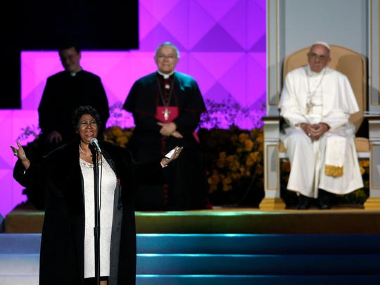 Aretha Franklin performs as Pope Francis is seated nearby during the Festival of Families, Saturday, Sept. 26, 2015, in Philadelphia.