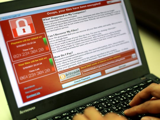 "A programmer shows a sample of a ""ransomware"" cyberattack on a laptop. The Las Cruces Public Schools was attacked by a ransomware virus on Oct. 29 and will need to clean 30,000 devices district-wide before allowing them access to internet service."