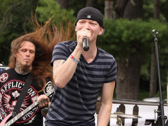 Unhinged lead singer Mike Butterworth rocks out for the crowd along with bass guitarist Bunky Edwards at Leilapalooza in 2014,