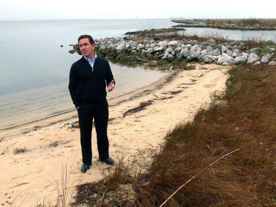 Pensacola City Councilman Brian Spencer, shown standing