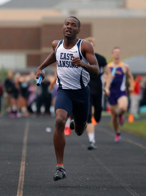 East Lansing's Kentre Patterson runs in the 4x400 meter relay Friday, May 20, 2016, in Holt, Mich.
