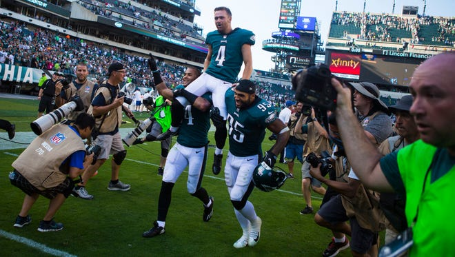 Eagles kicker Jake Elliot is carried into the locker room by Kamu Grugier-Hill, left, and Mychal Kendricks after Elliot scored the 61-yard game winning field goal to defeat the Giants 27-24 Sunday at Lincoln Financial Field.