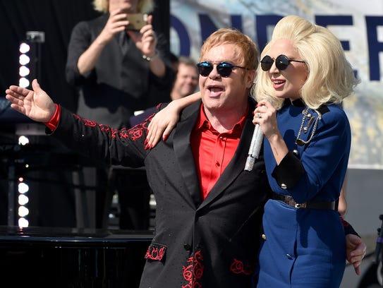 Lady Gaga, right, joins Elton John and his band at