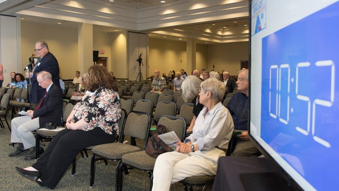 Okaloosa County commissioner Graham Fountain, left, speaks during the Constitution Revision Commission's public hearing on proposals under active consideration held at the University of West Florida in Pensacola on Tuesday, February 27, 2018.