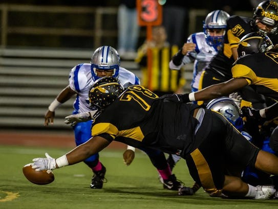 Piscataway's Terrell Hagans recovers a fumble against