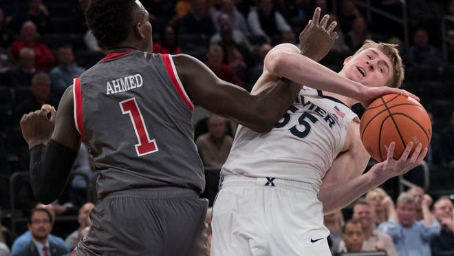St. John's guard Bashir Ahmed (1) guards Xavier guard J.P. Macura (55) during the first half of an NCAA college basketball game in the quarterfinals of the Big East conference tournament, Thursday, March 8, 2018, at Madison Square Garden in New York. (AP Photo/Mary Altaffer)