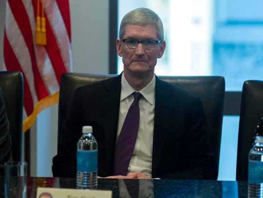 Apple CEO Tim Cook attends a meeting of technology