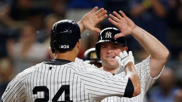 New York Yankees' Brian McCann greets Gary Sanchez