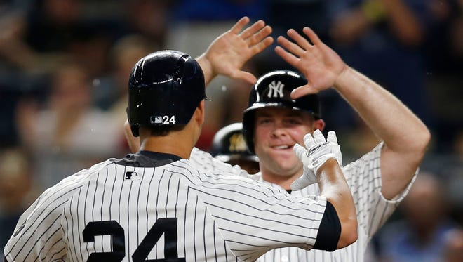 New York Yankees' Brian McCann greets Gary Sanchez (24) after scoring on Sanchez's fourth-inning home run in a baseball game against the Toronto Blue Jays in New York, Tuesday, Aug. 16, 2016.