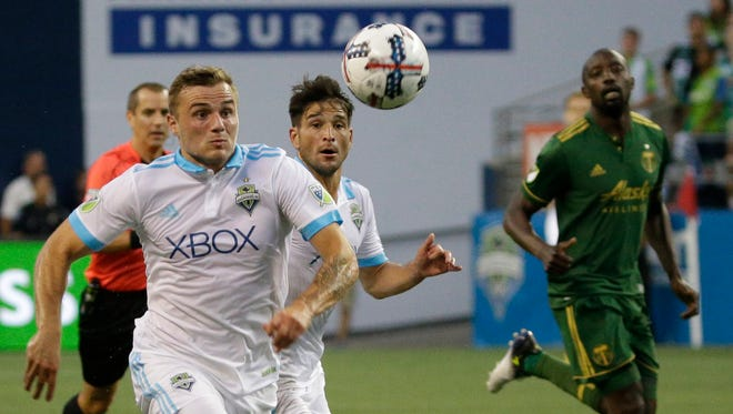 The Sounders announced that forward Jordan Morris, left, will miss at least a few weeks with a serious hamstring strain.