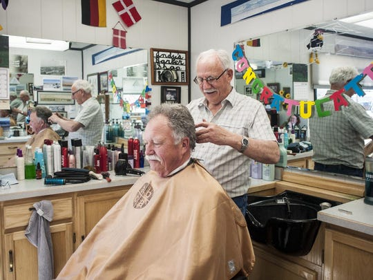 """Don """"Andy the Barber"""" Andersen cuts Pastor Jack Bell's hair at his Stanford barbershop. On May 5, Andersen will celebrate 55 years as a barber in Stanford. """"It's been a fun profession,"""" he says. """"For a person like me, I worked in a grocery store when I was 14 so it's been people 100 percent. The Lillegard family, I've done six generations with them."""""""