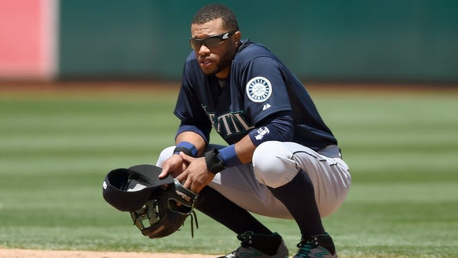 Robinson Cano of the Seattle Mariners looks on while the umpires review a play against the Oakland Athletics on July 5, 2015, in Oakland, California.