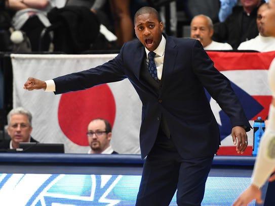 George Washington coach Maurice Joseph gestures in