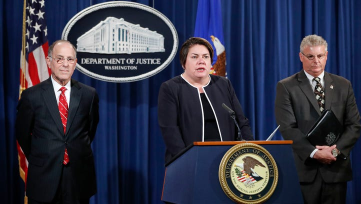 Assistant Attorney General Leslie R. Caldwell, center,