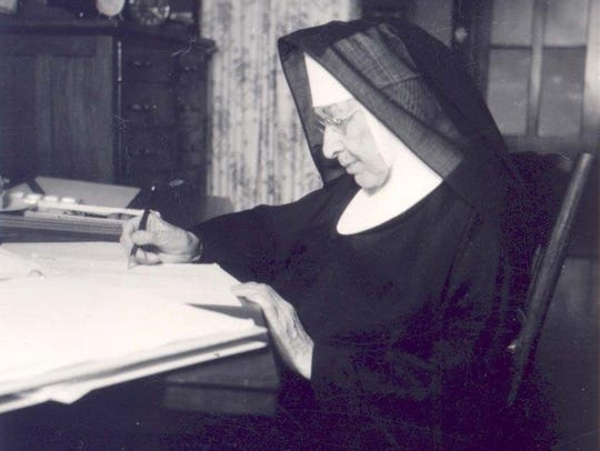 Sister Justina Knapp at work.