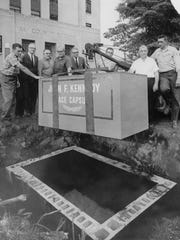 Bay County officials lower the time capsule into the ground in September, 1965.