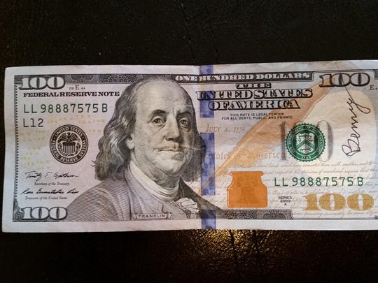 This $100 bill signed by Benny was found by Monica McCord in a plastic envelope purchased at the Fred Meyer on Commercial Street SE.