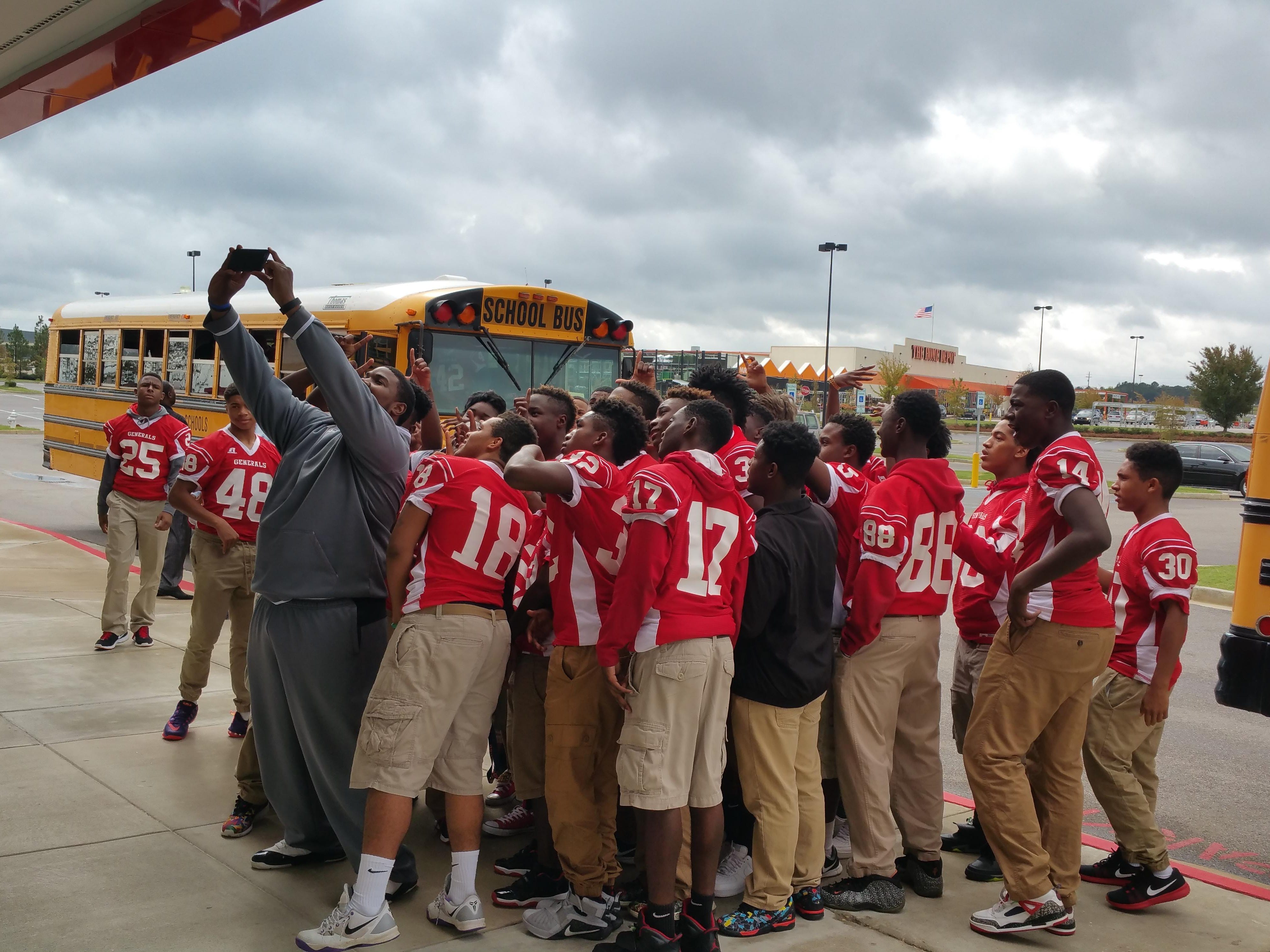 """Robert E. Lee High School football players get in a picture before seeing a screening of """"Woodlawn"""" at Carmike Cinemas Chantilly 13 on Wednesday."""