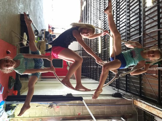 Children learn about balance during an activity at the Cincinnati Circus Camp.