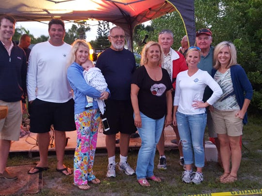 The 2016 Capri Community Inc. board of directors is recognized for organizing and hosting the largest picnic the community organization has ever had. From left, back row: Randy Whitson, president, Beau Middlebrook, Gary Goetzelman, Joel Fitzjarrald, and John Cowden. Front row: Kelly Sprigg holding baby Ruby Sprigg, Joyce Beatty, Amanda Ray and Laura Mikula.