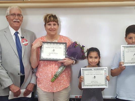 Detroit Goodfellows President Marshall Hunt, winning teacher Jacqueline Wald