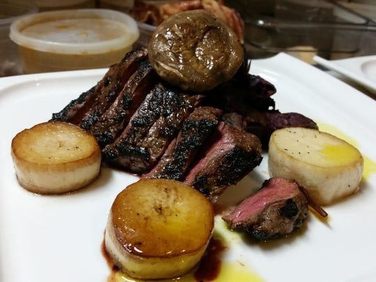 """Bison skirt steak with roasted purple sweet potatoes and King Oyster mushroom """"scallops."""""""