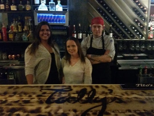 Heather Thompson Hamilton, center, is the new owner of Tally's Restaurant Bar and Catering in Beaverdale. Samantha Armstrong, left, is the manager, and Keith Johnson, right, is the executive chef.