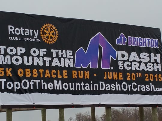 A banner recognizing the upcoming Brighton Rotary Club event Top of the Mountain Dash or Crash is placed on a billboard along Interstate 96 in Genoa Township. The event is June 19, 2018 starting at 11 a.m. at Mt. Brighton Ski Area.