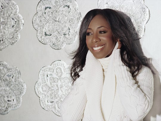 "Oleta Adams, performing in ""The Colors of Christmas."""